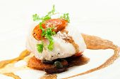 Gourmet Main Entree Course Grilled Snow Fish with brown sauce