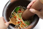 image of green papaya salad  - making of green papaya salad - JPG