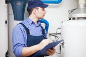 image of hot water  - Technician servicing an hot - JPG
