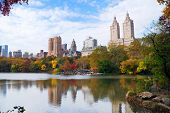 New York City Manhattan Central Park panorama in Autumn lake with skyscrapers and colorful trees wit
