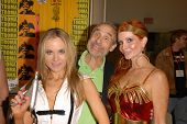 Paula Labaredas as Barbarella, Lloyd Kaufman and Phoebe Price as Wonder Woman members at San Diego C