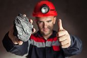 Coalminer With Lump Of Coal