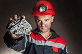 Coalminer Showing Lump Of Coal