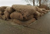 foto of sandbag  - A low wall of sandbags in place for flood protection - JPG