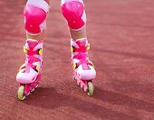 Rollerblades Inline Skates Of A Child Closeup In Action Outdoors