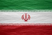 stock photo of iranian  - flag of Iran or Iranian banner on canvas texture - JPG