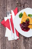 Portion Of Fried Cheese With Cranberries