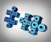 pic of merge  - Business puzzle coming together as a success metaphor with two three dimensional jigsaw pieces made from gears and cog wheels merging and joining as a strong partnership through planned teamwork - JPG