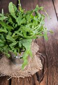 picture of rocket salad  - Portion of fresh Arugula Salad on wooden background