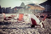 Beach Chairs And Umbrella On Beach In Rio De Janeiro