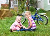 two girls playing on the green grass