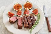 A juicy steak with figs
