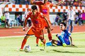 Sisaket Thailand-june 21: Todsapol Karnplook Of Sisaket Fc. (orange) Keep The Ball During Thai Premi