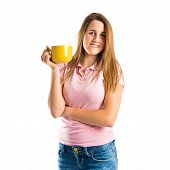Blonde Girl Drinking Coffee Over White Background