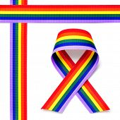 crossed rainbow ribbons and awareness ribbon on a white background