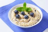 fruit oatmeal with fresh blueberries, decorated with mint