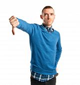 Young Man With Thumbs Down Over White Background
