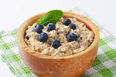 cereal oatmeal with fresh blueberries on top