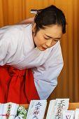 Miko (Japanese Priestess) at Dazaifu Tenmangu in Fukuoka
