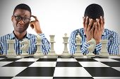 Young businessman with head in hands with chessboard against white background with vignette