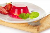 The jelly, decorated with strawberry and mint