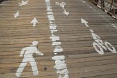 Bicycle and pedestrian path on the wooden pedestrian walkway on the center of the Brooklyn Bridge