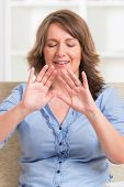 Woman practicing Reiki transfering energy through palms, a kind of energy medicine.