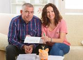 Couple signing life insurance contract at home