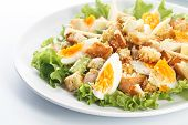 Caesar Salad With Eggs, Lettuce, Croutons, Parmesan, And Chicken Breast