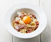 Pasta Carbonara On White Plate With Parmesan And Yolk