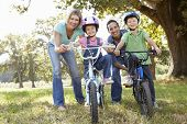 Parents with young children on bikes