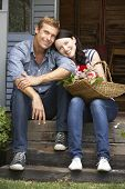 Couple sitting  on veranda