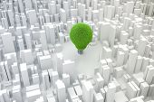 3d image of light bulb made of grass and city, green energy concept