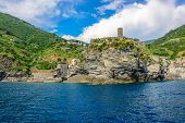 Scenic view of beautiful village Vernazza and ocean coast in Cinque Terre, Italy