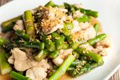 foto of fried chicken  - Freshly prepared Asian style chicken and asparagus stir fry with garlic - JPG