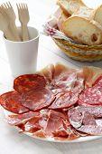 various types of  spanish salami, sausage and ham. fuet galidad, jamon serrano, chorizo, salchichon and jamon iberico