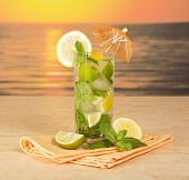 Sunset. Mojito in a glass