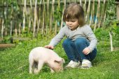 White piglet in girls hands smiling