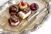mini bavarian cream dessert with vintage silverware