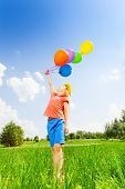 Girl with colorful balloons wears flower circlet