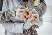 Cute couple in warm clothing holding hands on a chilly day