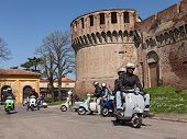 Bikers Riding A Vintage Italian Scooters