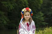 stock photo of national costume  - girl in ukrainian national costume posing outdoors - JPG