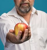 Man Holding Red Apple In Hand