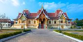 Facade of Wat That Luang Neua near golden stupa in Vientiane, Laos
