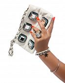 closeup of the womans hand wearing luxury ring, orange nail art manicure with white leather bag with silver chain bag, isolated on white studio background