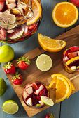 image of sangria  - Homemade Delicious Red Sangria with Limes Oranges and Apples - JPG
