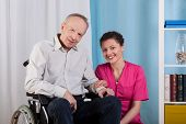 stock photo of hospice  - Disabled man and his nurse in a hospice - JPG