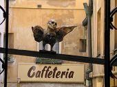 Prague, Czech Republic - June 15, 2006: Man-bird Sculpture In Old Town Patio Near Caffeteria Cafe On