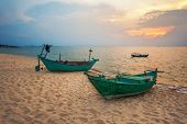 Old fishing boat at the beach in sunset time.Phukok island. Vietnam
